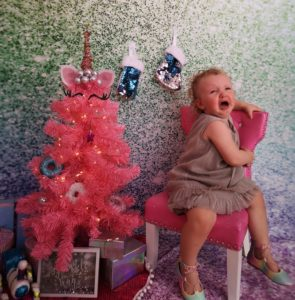 Bettie crying during a Christmas card photoshoot